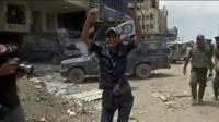 Iraqi fighter celebrates in Mosul