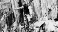 Quarry worker on rope