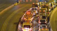 A convoy of ambulances.