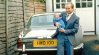 Harvey Bowden holding his baby child
