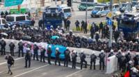 German police surround protesters who tried to block off access to the exhibition centre where the Alternative for Germany (AfD) is to hold its party convention, in Stuttgart, Germany, 30 April 2016