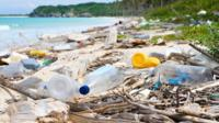 Plastic bottles on a beach.