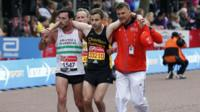 Matthew Rees helps David Wyeth over the finish line