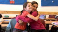 Jewish girl and Arab girl hugging