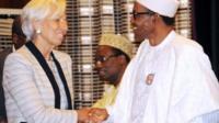 hristine Lagarde (L) shakes hands with Nigeria's President Muhammadu Buhar