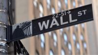 A Wall Street sign