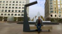 BBC Click's Spencer Kelly sits on a solar bench