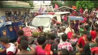 Philippines police van confronts protesters