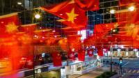 Flags of China and Hong Kong above a street