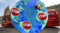 "A globe with ""stop"" signs across various countries and Theresa May's face covering the UK."