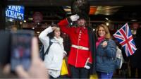 Tourists with a London guard