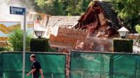 Bulldozers destroy OJ Simpson's home in 1998