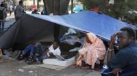 Africans sleeping rough at Porte de la Chapelle, Paris