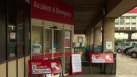 The front of an Accident and Emergency unit, with signs saying 'Major incident declared' outside