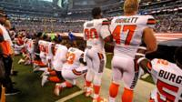 Some Cleveland Browns players kneel and others stand during protest on Sunday.