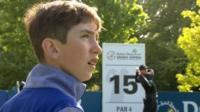 Tom McKibben watches Rory McIlroy playing a shot