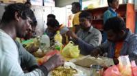 Men eating rice