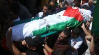 Palestinian men carry the body of Saad Dawabsha