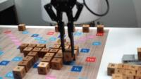 Dave Lee challenges a robot at Scrabble