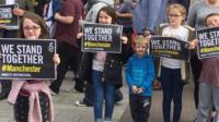 Children at a gathering in Manchester to remember victims of the attack.