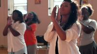 Young women performing a Step dance routine in a scene from Step