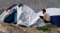 Man sitting near tent on Chios
