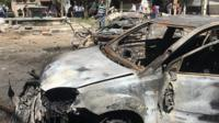 A car damaged in Tahrir square following the blast