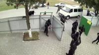 masked men with guns entering property