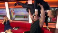 Dan Walker being bench pressed