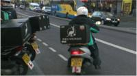 Delivery driver on moped.