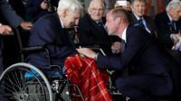 Prince William, patron of the Battle of Britain Memorial Flight, speaks with Ken Wilkinson, Battle of Britain pilot