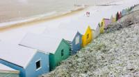 Snowy beach huts in Southwold
