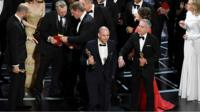 Various actors on stage at Oscars ceremony