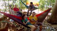 People relax in hammocks outside of Cuba Libro.