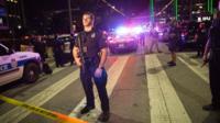 Policeman standing near crime tape