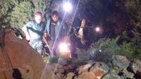 Xisco Gracia being helped from the cave by two rescuers