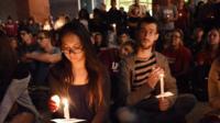 People attending vigil