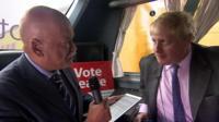 Boris Johnson talking to John Pienaar