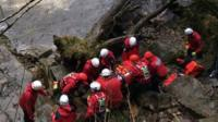 Rescuers help injured kayaker