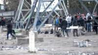 """Migrants clash near the site of the old """"Jungle"""" camp"""
