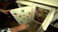 White goods inside flooded home