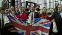 Supporters hold Union flag