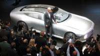 Dieter Zetsche poses with a Mercedes prototype model at the Frankfurt Motor Show
