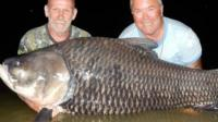 Anglers with huge fish
