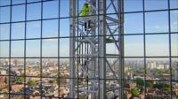 Andrew Marr climbs a crane to get above the Shard