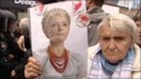 Protester holds Tymoshenko's picture