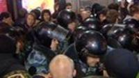 Police amongst protesters in Russia