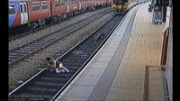 A woman stumbles in front of a train
