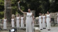Actresses perform during ceremony to light Olympic flame