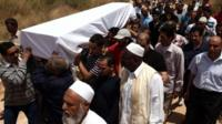 Friends and relatives carry the coffin containing the body of Abdelbaset Ali Mohmet al-Megrahi